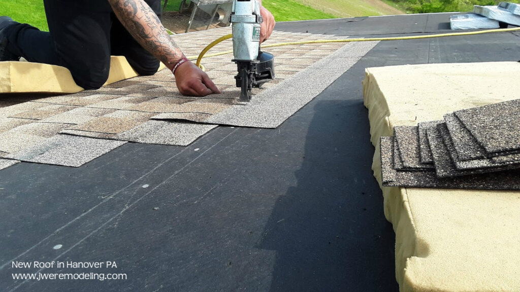 Laying the Shingle Pattern for this new roof in Hanover PA by JWE Remodeling & Roofing