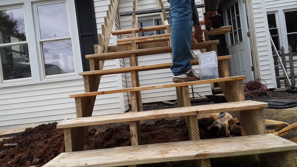 Exterior stair-case being built during Manchester, MD 21088 remodeling project by JWE