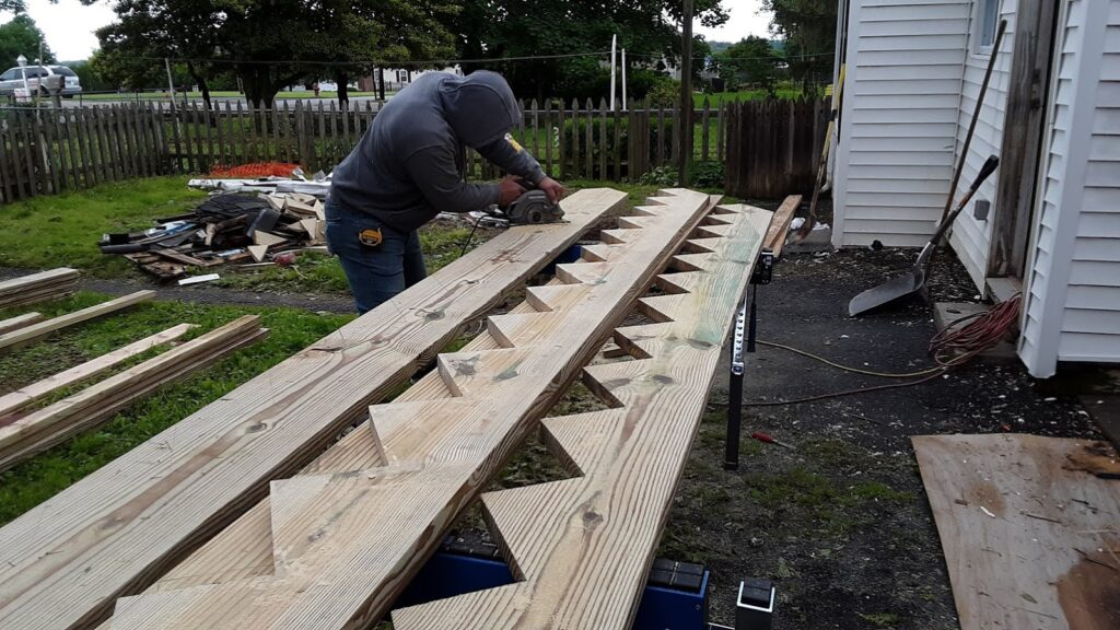 Cutting the stringers for this exterior stair case in Manchester MD 21088 home improvement contractor JWE