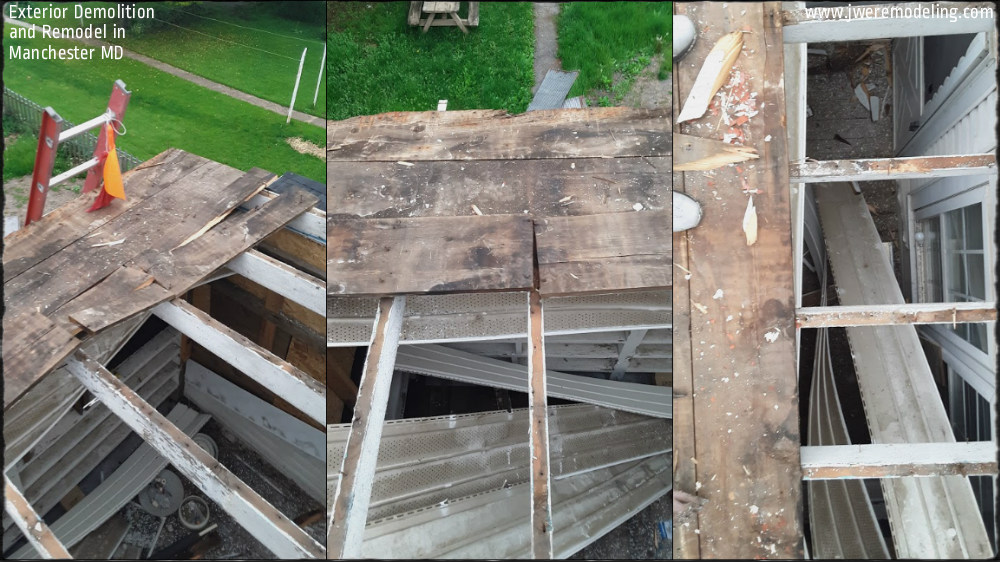 Demolishing the floor of the old structure, exposing the joists from the ceiling below.