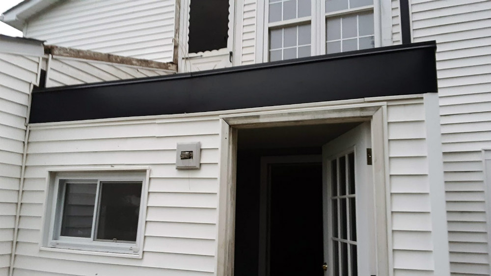 Exterior metal wrapped trim in black on white home color scheme