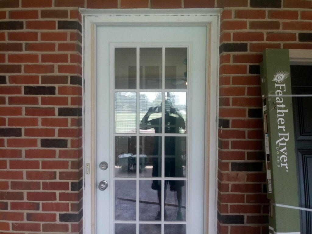 New Installed Door in Garage Addition Remodel by Contractor JWE
