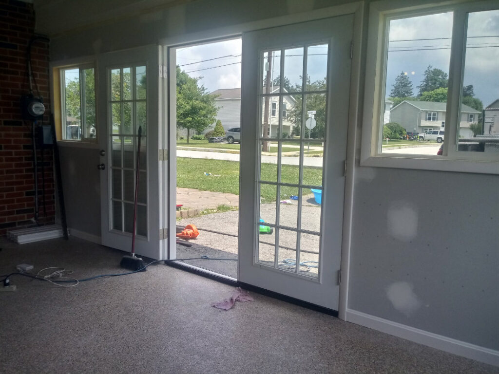 Custom trim around walls and windows in this garage addition