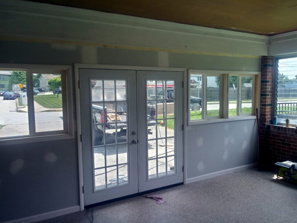Custom trim installed around door and windows in Hanover PA garage addition