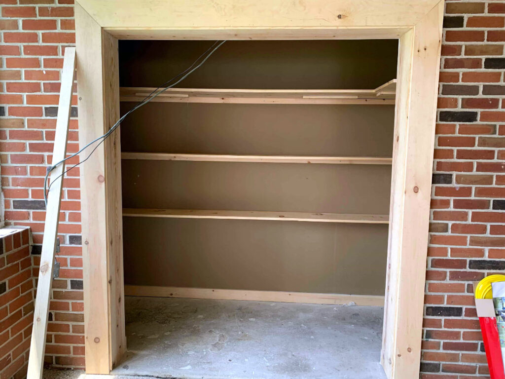 The newly finished interior closet with custom shelving