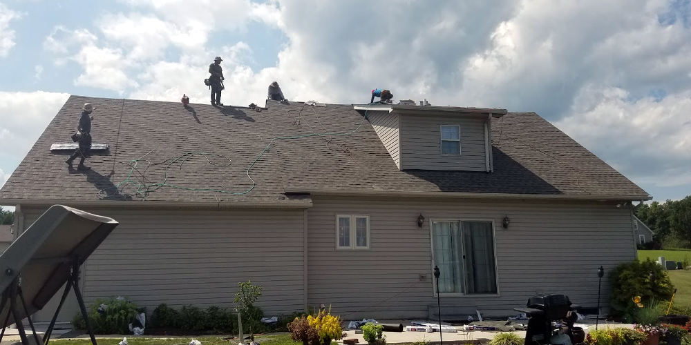 Abbottstown PA Roofing Service: Roof Replacement by JWE - our roofing crew hard at work installing a new GAF lifetime roofing system in Abbottstown PA