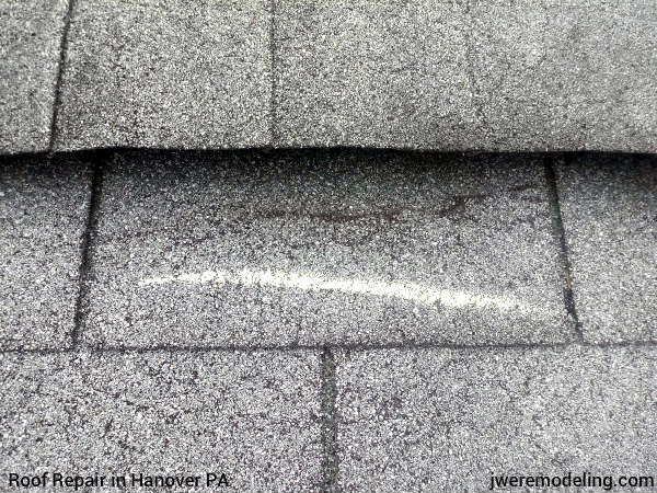 Damage to shingles at the peak of a roof in Hanover PA caused by storms