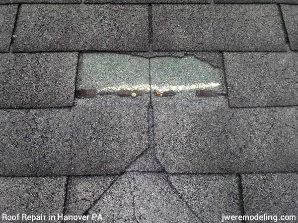 Blown-off shingles and missing shingles indicates severe storm-related wind damage and are paid for by insurance in Hanover PA