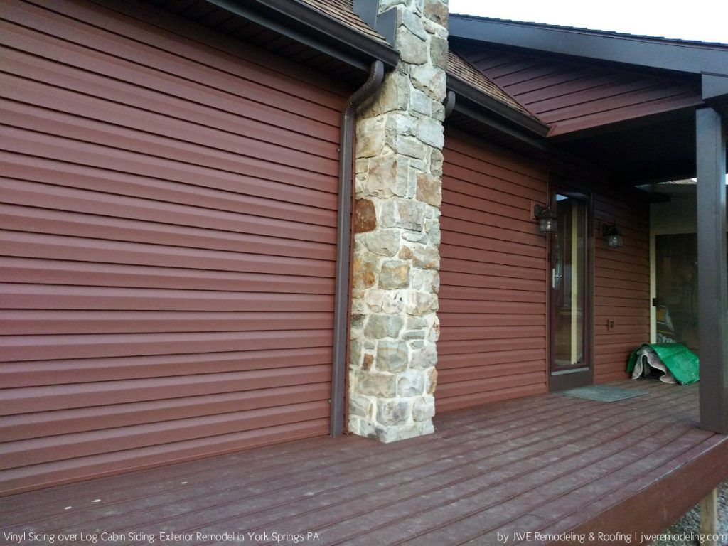 Log Cabin Remodel: Covering the Log Siding with Vinyl Siding. An Exterior Renovation in York Springs PA by JWE Remodeling and Roofing Contractors
