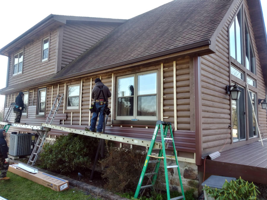 Covering a rustic log cabin home with new vinyl siding, new custom metal trim and more. Remodeling in York Springs PA 17372 by JWE siding contractors