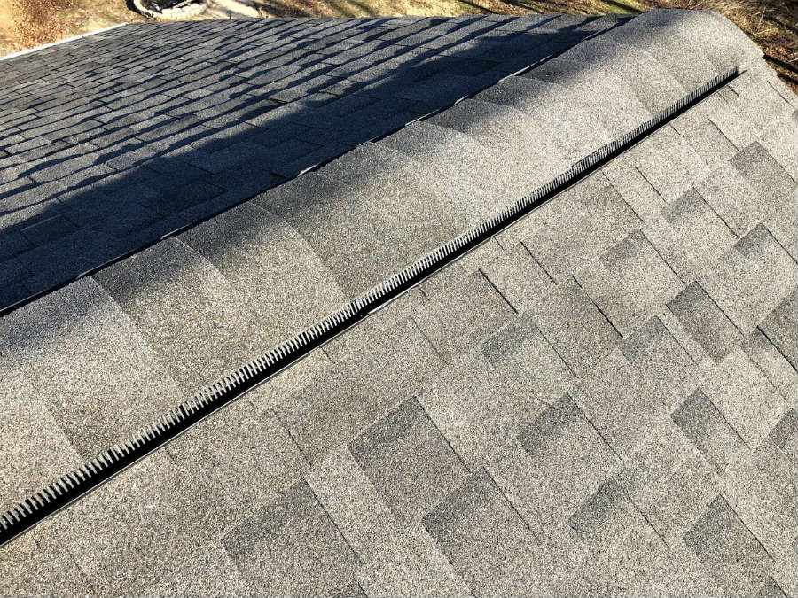 Close up of the roofing ridge vent: IKO Cambridge Driftwood architectural asphalt shingles