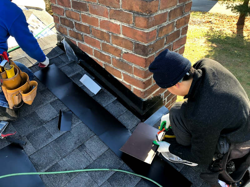 Installation of the chimney flashing in Gettysburg PA by JWE Roofing Contractors