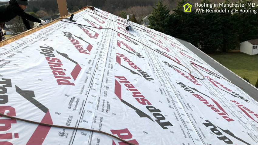 Underlayment installation as part of a full roofing system installation in Carroll County MD by JWE roofing contractors