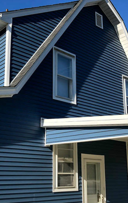 Storm damage restoration services for roofing and siding hail and wind damage by JWE Remodeling