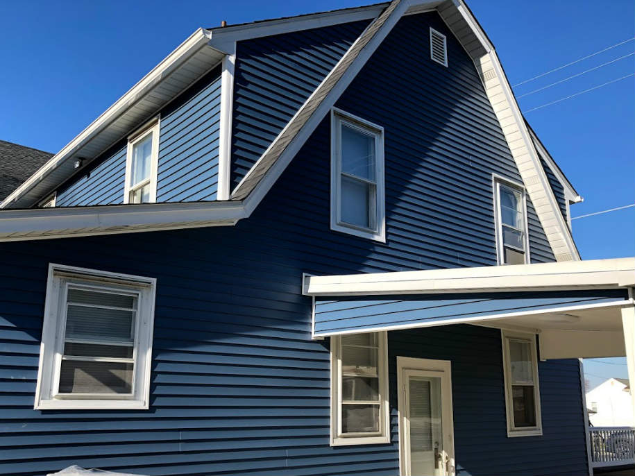 New roofing and siding due to hail and wind storm damage in Hanover PA by JWE Remodeling and Roofing Contractors 17331