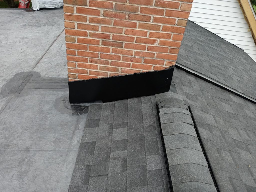 Dover PA roof replacement by JWE Remodeling & Roofing contractors in 17315: new chimney flashing and ridge vent with ridge caps