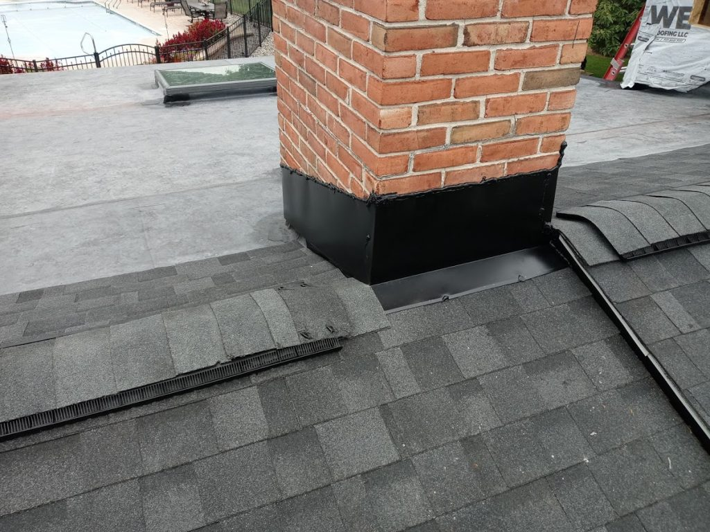 New Roof Installation in Dover PA 17315 by JWE Roofing Contractors: close-up of the chimney flashing