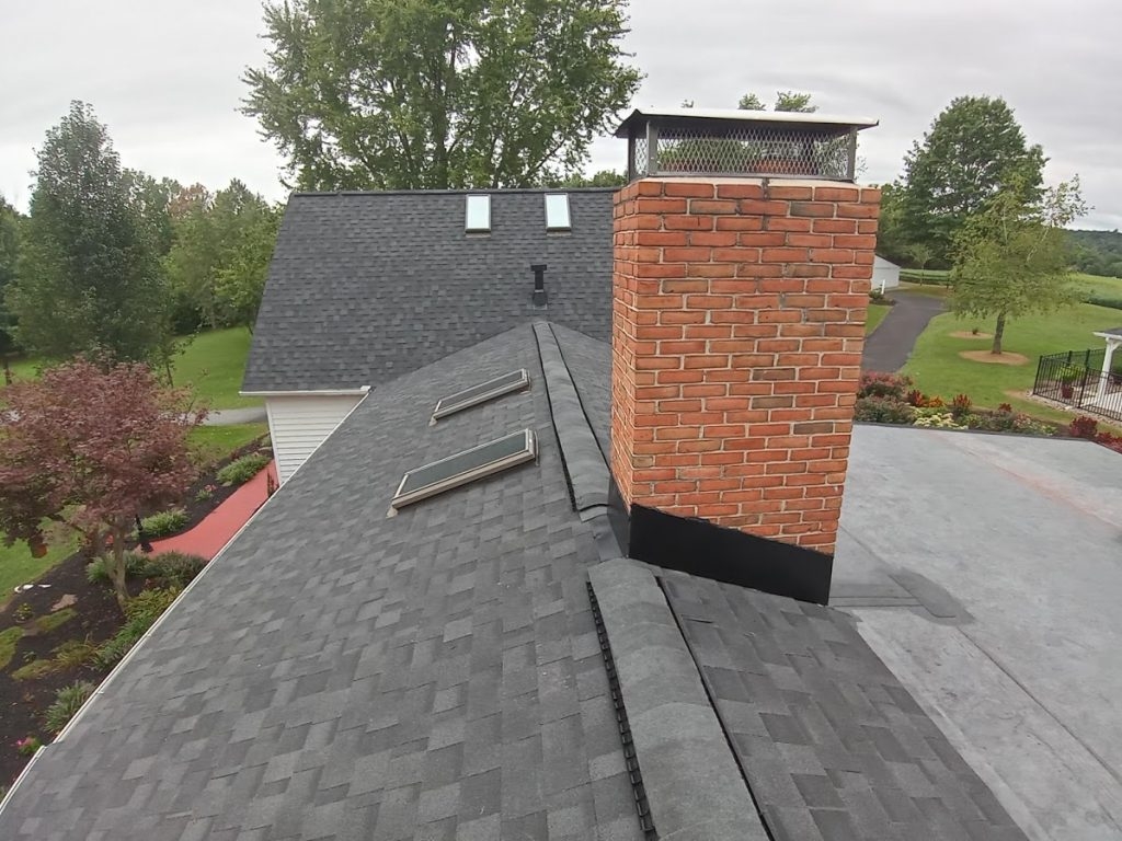 Dover PA roof replacement by JWE Remodeling & Roofing contractors in 17315: new chimney flashing and ridge vent, asphalt shingle roof