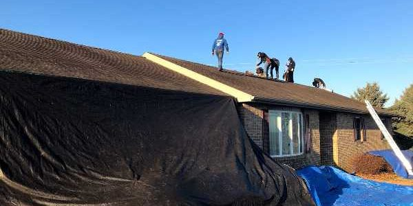 Roofing contractor JWE executing a roof replacement service in Seven Valleys, PA 17360